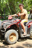 Happy asian boy on quad bike atv Stock Photos