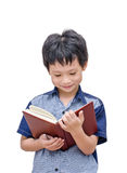 Happy Asian boy reading a book Stock Photo