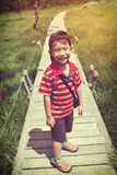 Happy asian boy relaxing outdoors in the daytime, travel on vaca. Happy asian boy smiling and looking at camera. Child relaxing at national park, outdoor with Stock Image