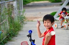 Happy Asian boy showing his  shell in his arms Royalty Free Stock Images