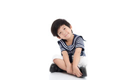 Happy asian boy sitting on white background Royalty Free Stock Photography