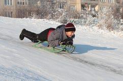 Happy asian boy on sledge Royalty Free Stock Photo