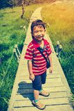 Happy asian boy relaxing outdoors in the daytime, travel on vaca. Happy asian boy smiling and looking at camera. Child relaxing at national park, outdoor with Stock Photo