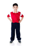 Happy Asian boy in sports red uniform Royalty Free Stock Images