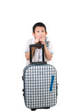 Happy Asian boy with a suitcase. Stock Photo