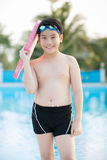 Happy asian boy in swimsuit coming up the pool Royalty Free Stock Photos
