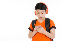 Happy asian boy using cell phone . Happy asian boy using cell phone with copy space  on white background Royalty Free Stock Photography