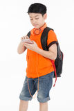 Happy asian boy using cell phone . Happy asian boy using cell phone with copy space  on white background Royalty Free Stock Photo