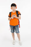 Happy asian boy using cell phone . Happy asian boy using cell phone on white background Royalty Free Stock Photo