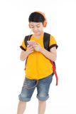 Happy asian boy using cell phone . Happy asian boy using cell phone on white background Royalty Free Stock Photos