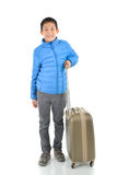 Happy Asian boy wearing blue down jacket Royalty Free Stock Photography