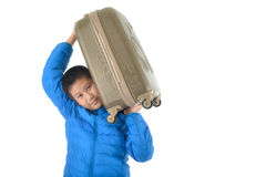 Happy Asian boy wearing blue down jacket Royalty Free Stock Images