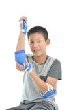 Happy Asian boy wearinghand guard for playing roller blades on w Stock Photo
