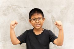 Free Happy Asian Boy With Glasses Hands Up And Smiling Over Grey Background. Royalty Free Stock Photos - 130349428