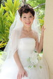 A happy asian bride. With beautiful wedding dress Stock Image