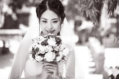 Happy asian bride with flowers Stock Photos