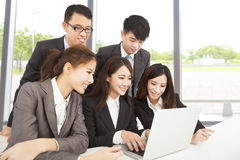Happy asian business team working in office stock photos