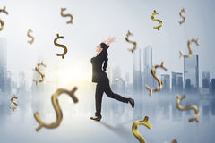 Happy asian business woman with falling money around her. On futuristic background Royalty Free Stock Images