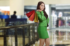 Happy asian business woman holding shopping bag Stock Images