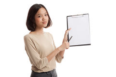 Happy Asian business woman point to clipboard with pen Stock Photography