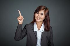 Happy Asian business woman point to her left Royalty Free Stock Images