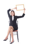 Happy asian business woman sitting and holding banner on white b Royalty Free Stock Photo
