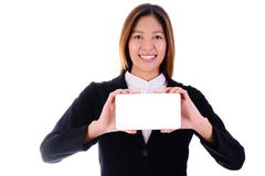 Happy asian business woman smiling and holding banner on white b Stock Photos