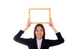 Happy asian business woman smiling and holding banner  on white Royalty Free Stock Photo