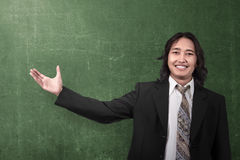 Happy asian businessman showing something Royalty Free Stock Images