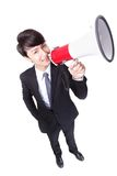 Happy asian businessman using megaphone. Isolated on white background, high angle view Stock Photos