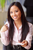 Happy asian businesswoman gives you business card Stock Images