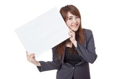 Happy Asian businesswoman hold blank sign obliquely Royalty Free Stock Image