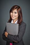 Happy Asian businesswoman hold a folder Royalty Free Stock Images