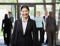 Happy Asian businesswoman holding briefcase Royalty Free Stock Images