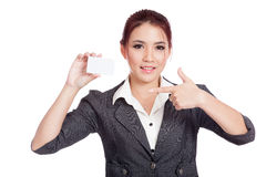 Happy Asian businesswoman pointing to a card Royalty Free Stock Images