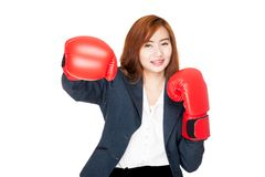 Happy Asian businesswoman punch with boxing glove Stock Photography