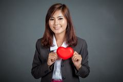 Happy Asian businesswoman show red heart on her chest Stock Photography