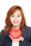 Happy Asian businesswoman show red heart on her palm hand Stock Photography