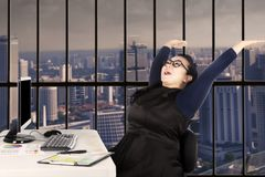 Happy Asian businesswoman at workplace Royalty Free Stock Photo