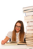 Happy asian caucasian girl lerning in study woth lots of books o Stock Images