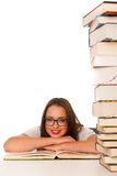 Happy asian caucasian girl lerning in study woth lots of books o Royalty Free Stock Photo