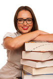 Happy asian caucasian girl lerning in study woth lots of books o Stock Photos