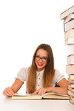 Happy asian caucasian girl lerning in study woth lots of books o Stock Image
