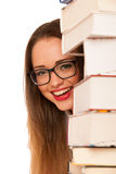 Happy asian caucasian girl lerning in study woth lots of books o Royalty Free Stock Images