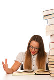 Happy asian caucasian girl lerning in study woth lots of books o Stock Photography