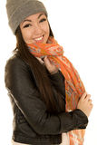 Happy Asian Caucasian teen model wearing a scarf and a beanie Royalty Free Stock Photo