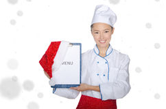 Happy asian chef with christmas menu and cap Royalty Free Stock Image