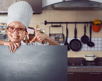 Happy asian chef showing menu sign on chalkboard Stock Images