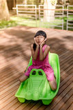 Happy Asian chidren playing at playground. Outdoor Stock Photo