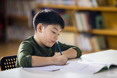 Happy asian child doing homework with smile face. Stock Images